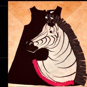 Girls' horse themed corduroy dress.
